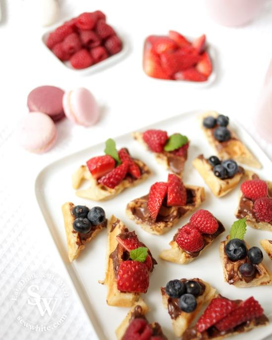 Bright summer berries on golden brown buttermilk waffle with bright red fresh berries. From the recipe Afternoon tea waffle bites by Sew White