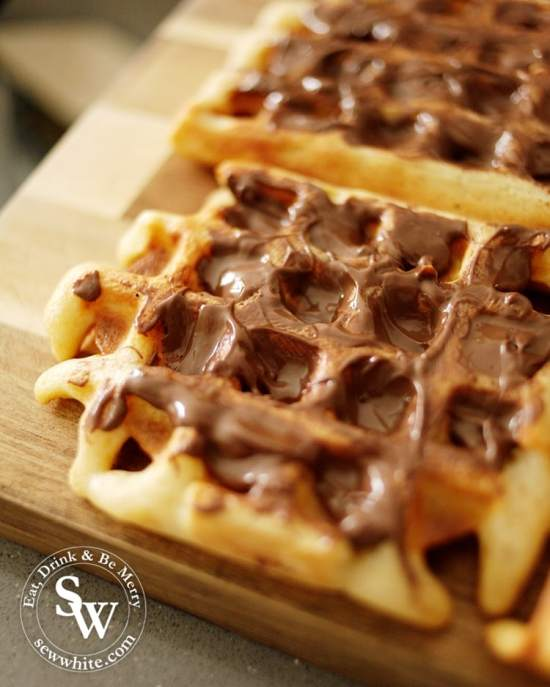 melted nutella on a hot buttermilk waffle ready for afternoon tea. From the recipe Afternoon tea waffle bites by Sew White