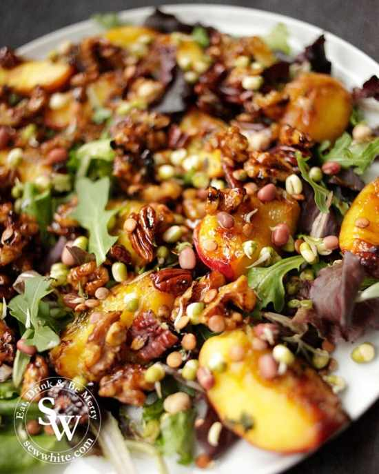 A beautiful Maple Syrup Grilled Peach and Nut Salad. Filled with  earthy green leaves, rich and warming caramelised fruit.