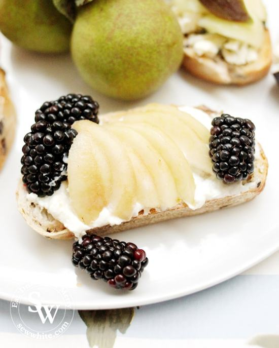 fresh blackberries, pear and cream cheese on toast