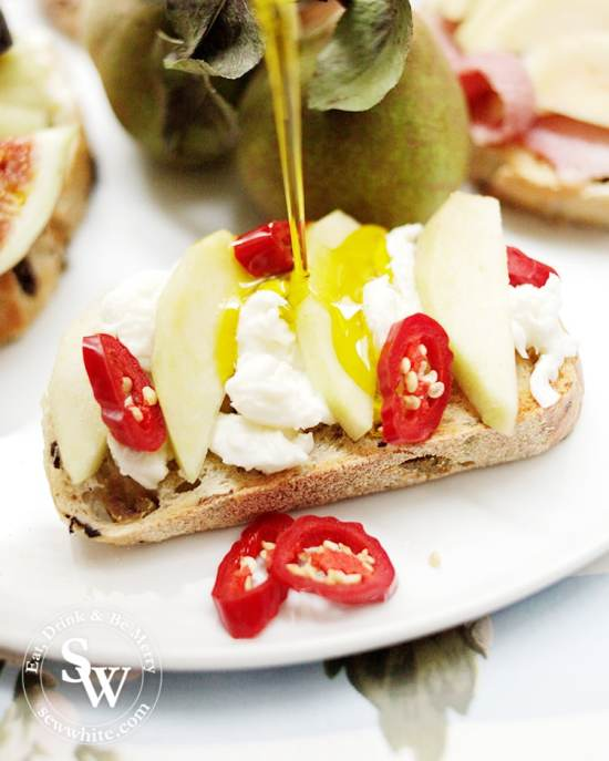 fresh pears on mozzarella and hot red chilli on sourdough toast.
