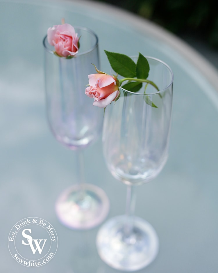 baby delicate roses balanced on champagne glasses for the Rose and Elderflower Fizz