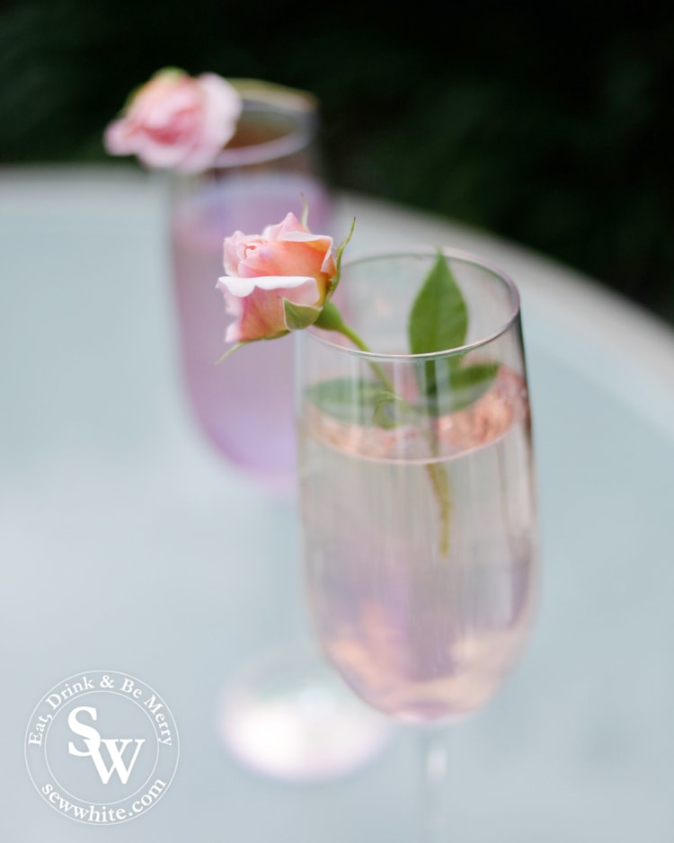 Rose and Elderflower Fizz with real roses in champagne glasses.