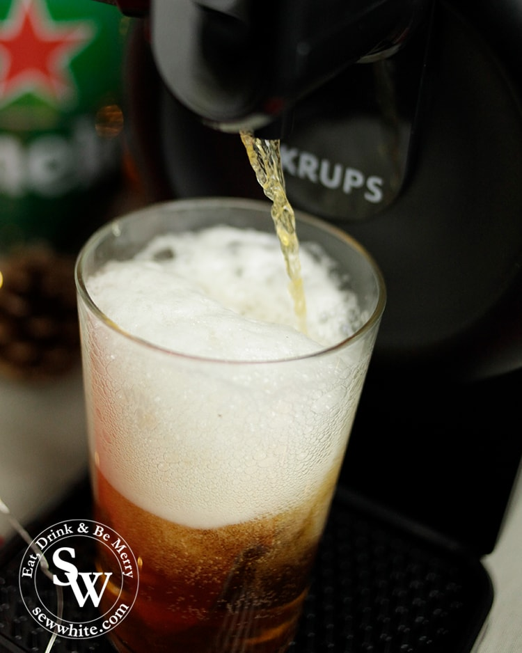 Beer being poured from the sub machine beer tap in the Top 5 Drinks for Christmas 2019