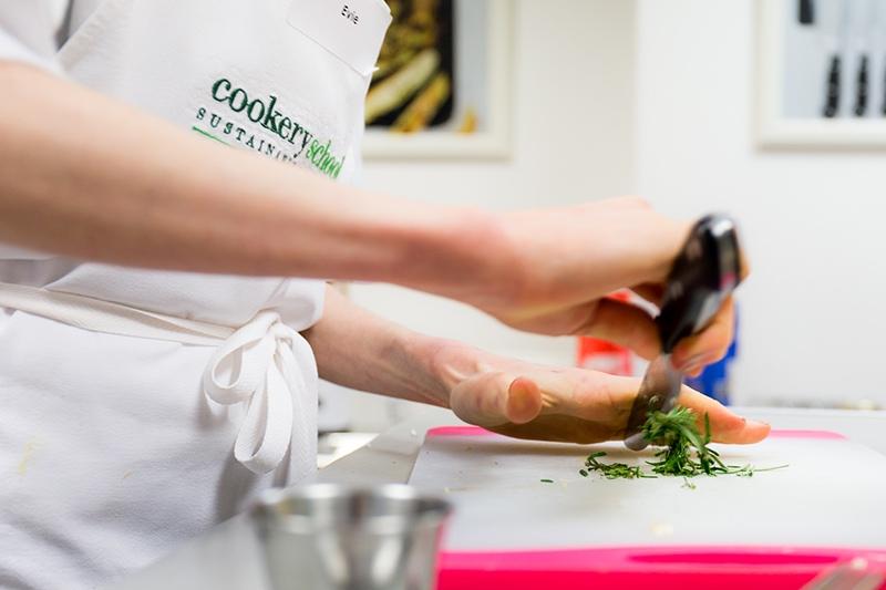 Cookery School London chopping herbs