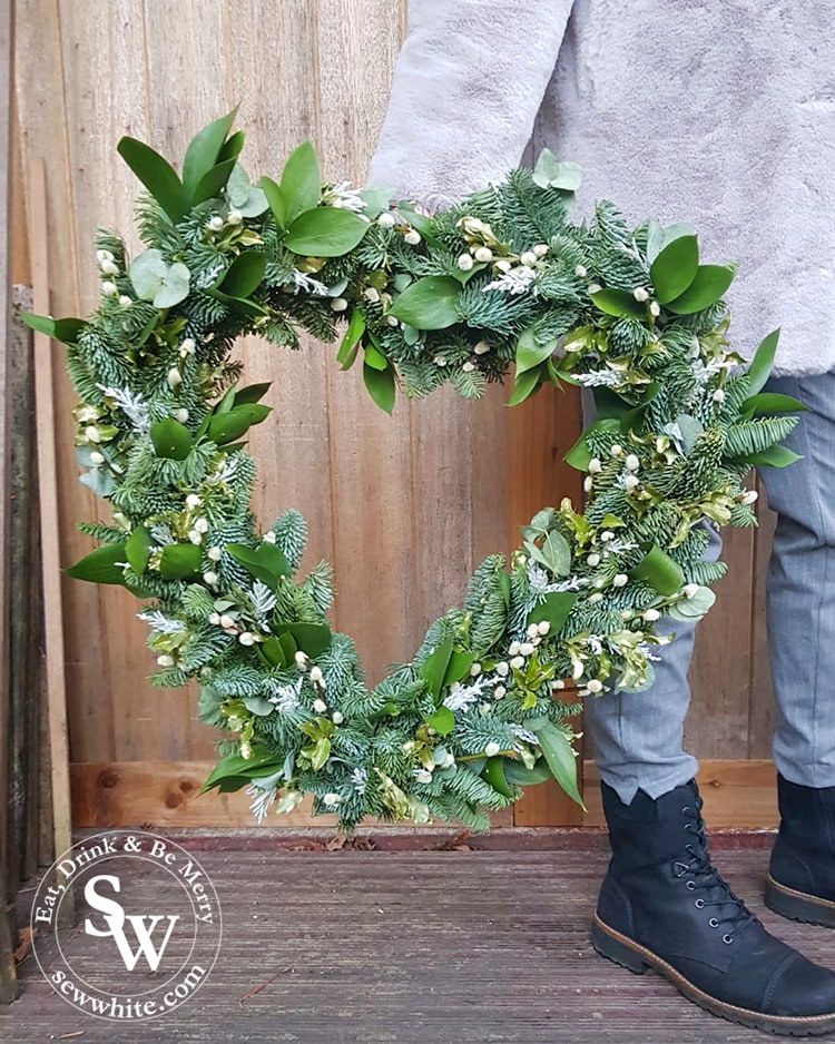 The finished giant heart wreath ready to hand up at Christmas. Studded with golden leaves and pussy willow.