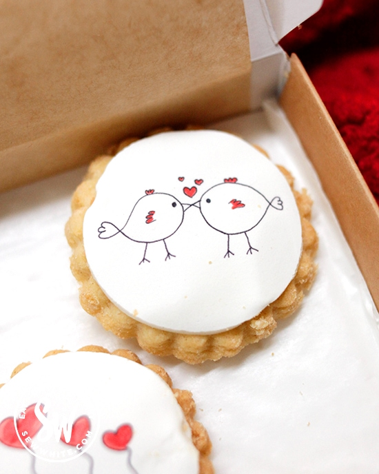 love birds kissing on an iced biscuit for Valentines Day by Bumble and Goose in the Valentine's Day Gift Guide