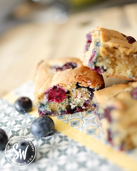 Blueberry Cookie Traybake cut up into slices ready to eat.