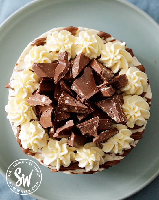 The Toblerone Cheesecake topped with extra Toblerone pieces on top.