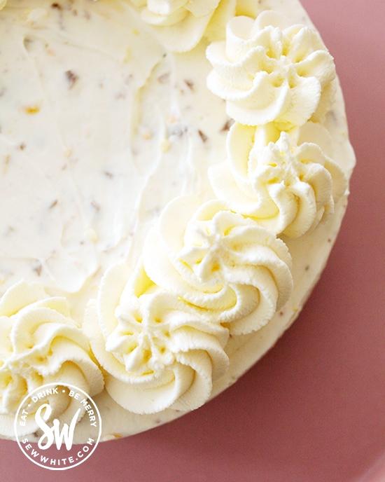 Beautiful cream swirls on the chocolate orange cheesecake