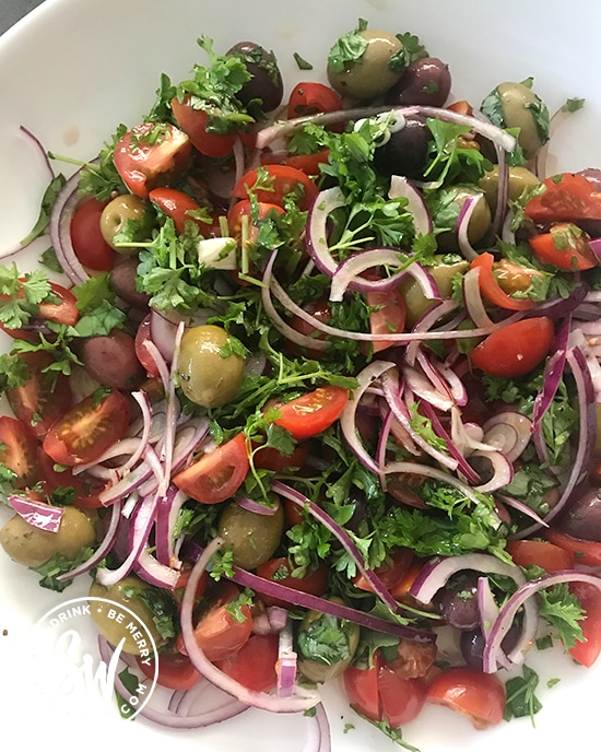 A beautiful mix of fresh parsley, basil, red onion, cherry tomatoes and mixed olives for the healthy leftover roast chicken pasta salad.