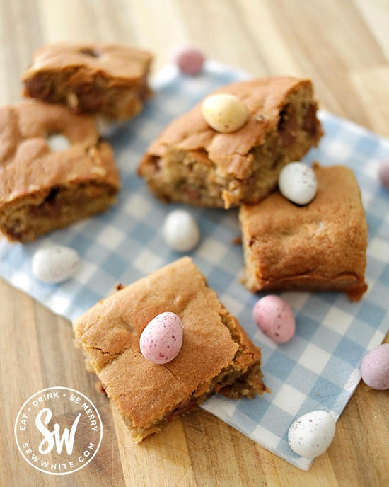 Easy Easter Traybake pieces on a blue gingham spring and Easter napkin.