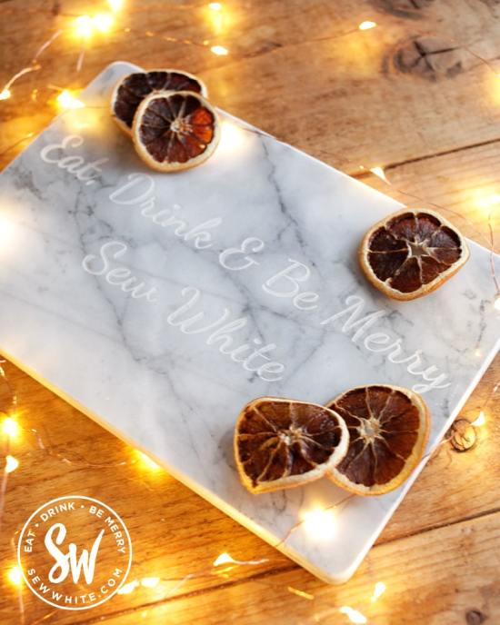 Eat, drink and be merry sew White marble chopping board for the be merry gift guide.
