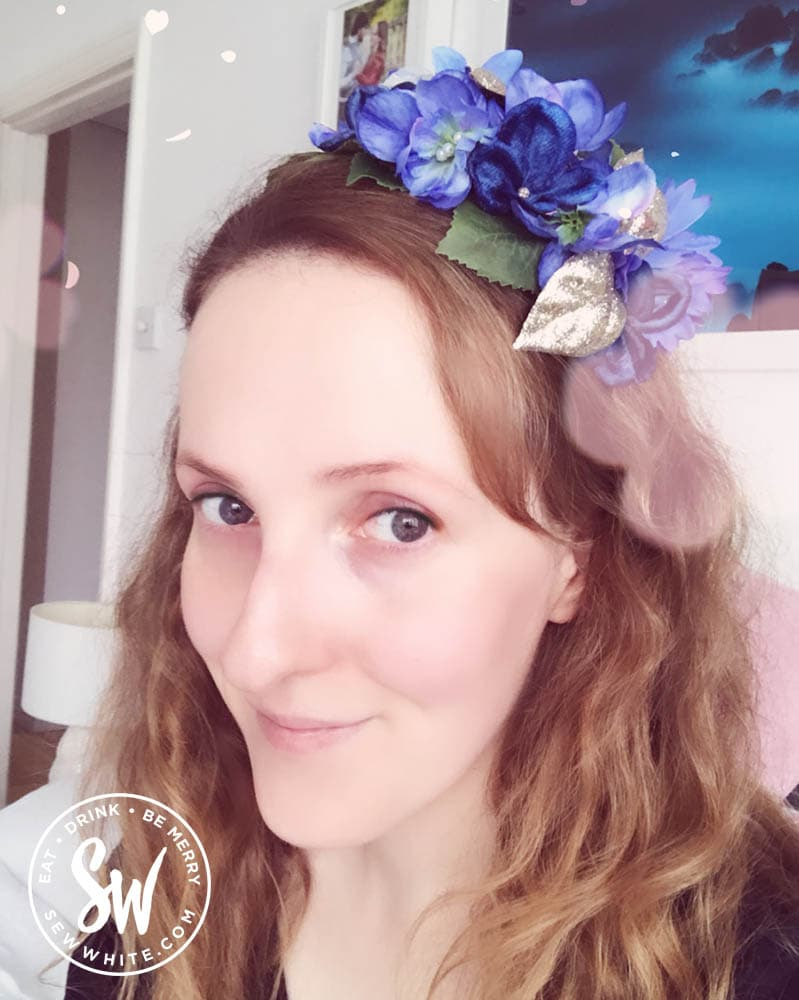 Sisley White in a floral headband from Bee Smith