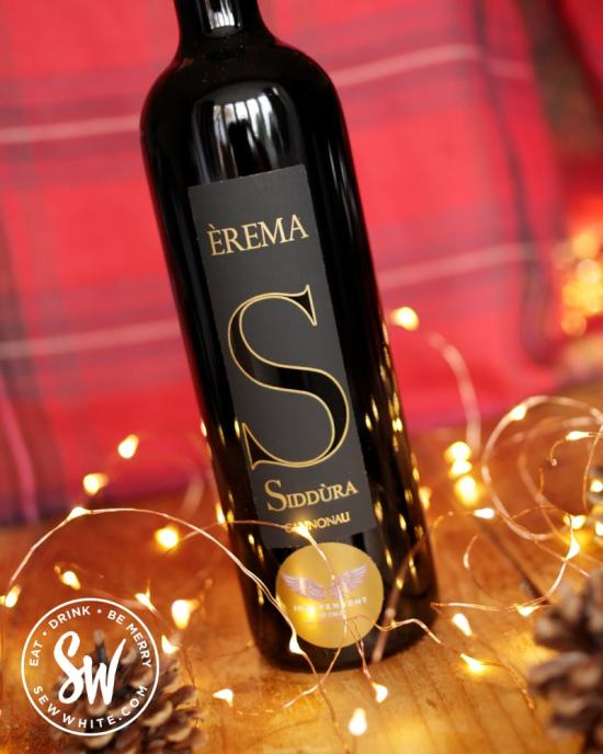 Siddura wine from Independent Wine on a wooden table with fairy lights in the drink gift guide