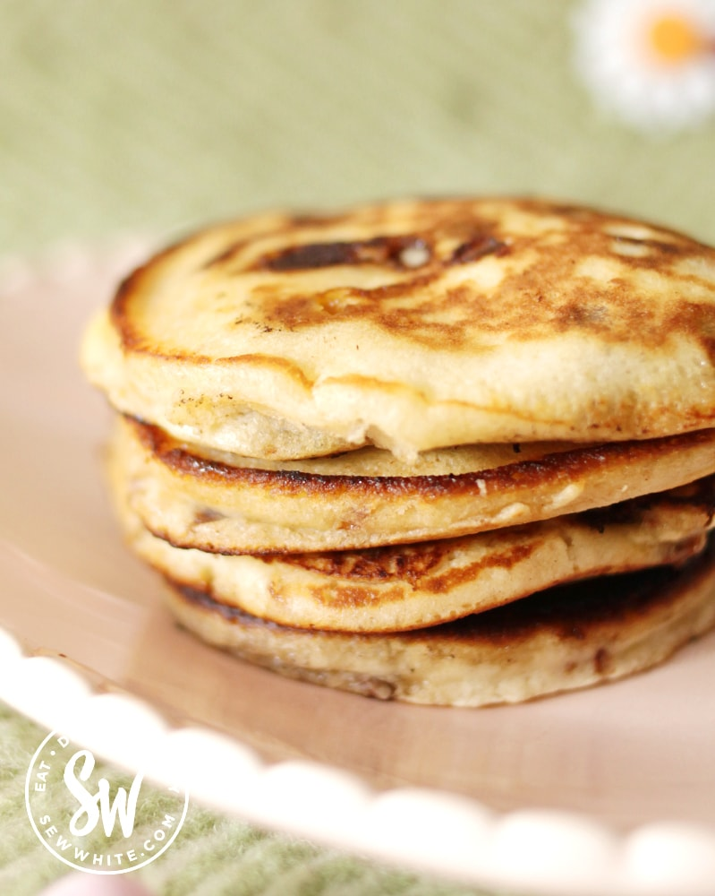 a stack of Easter pancakes on a pink plate - easy Easter brunch ideas