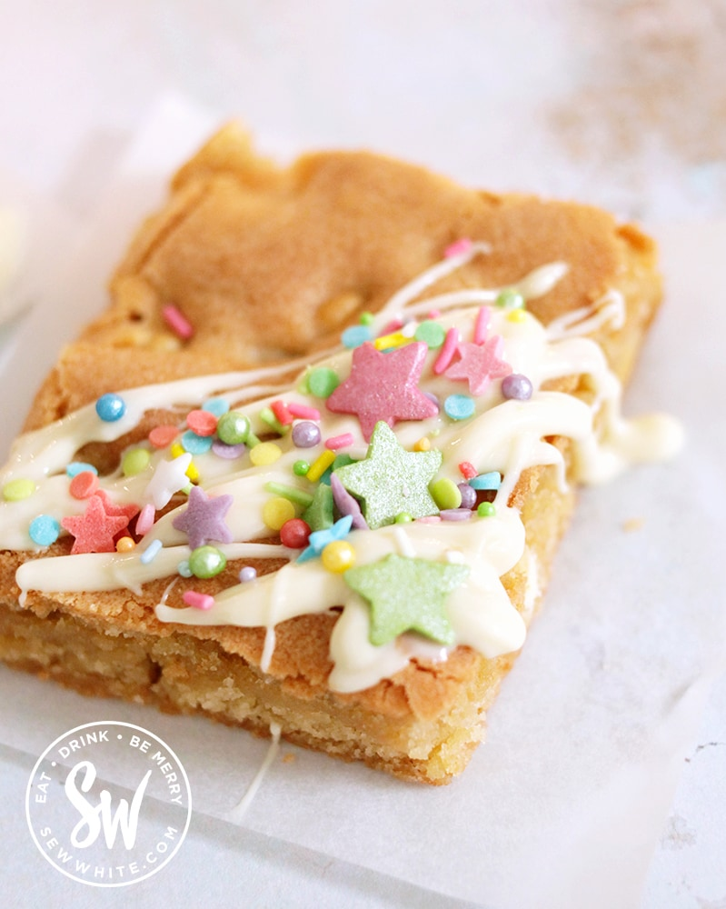 white chocolate blondies decorated with white chocolate and bright colour sprinkles