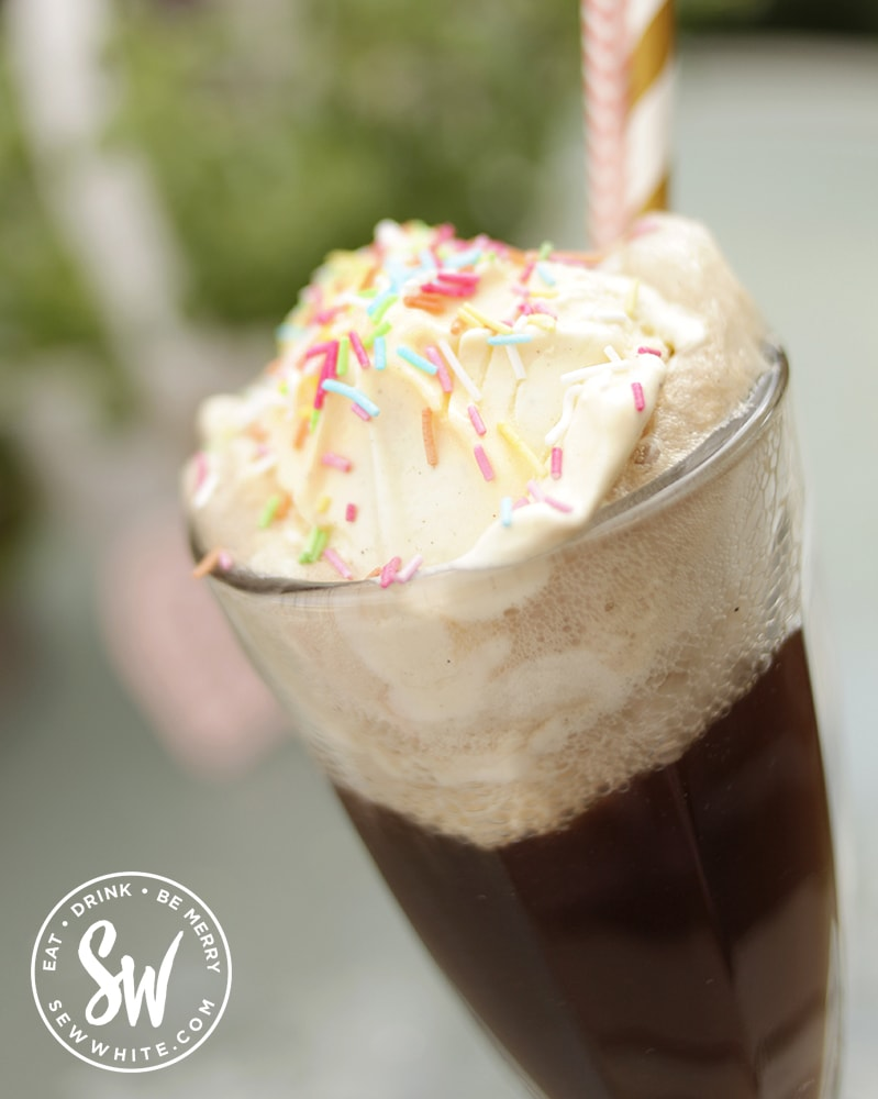 Close up of the Cola Float with sprinkles and straws