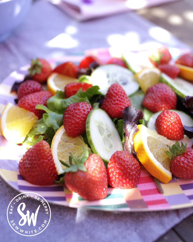 pimm's salad with slices of strawberries, cucumber and mint