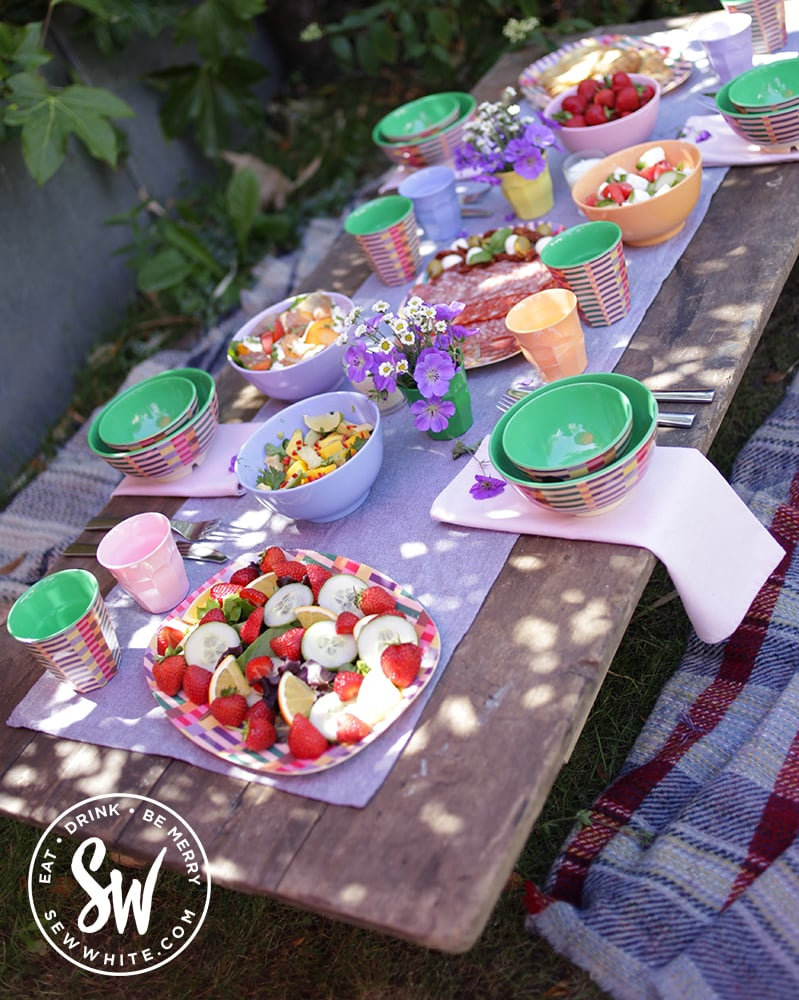 garden picnic table in pastel pinks and purples for the pimms salad / pimm's salad