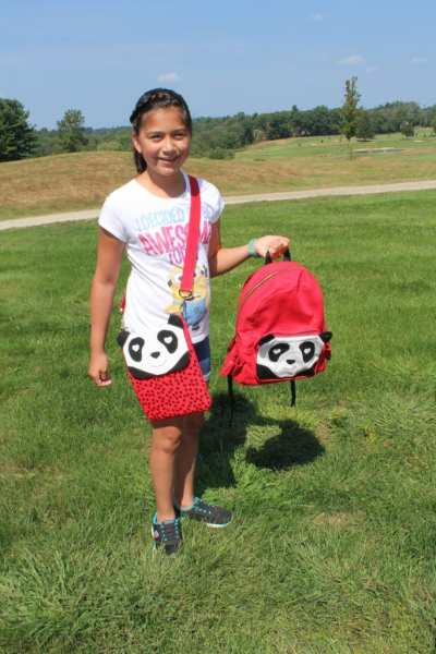 My Daughter with her Panda Backpack and Panda Tablet Bag.