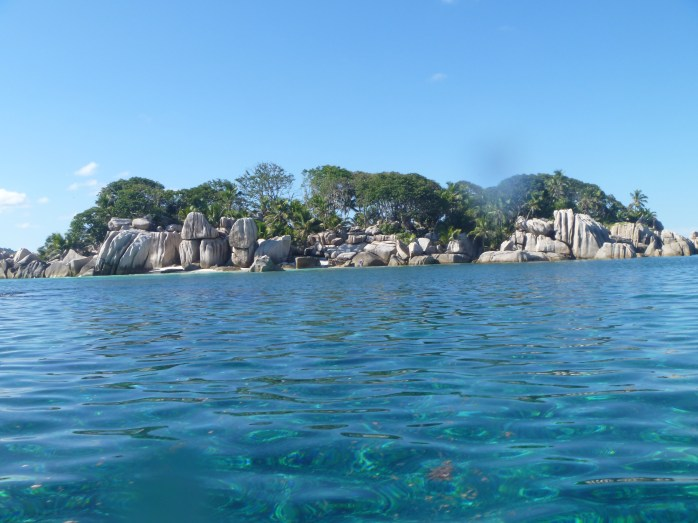 Playing on Rocks coco island seychelles