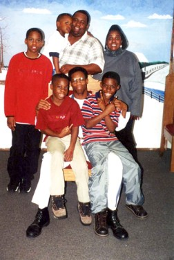 Eugene Thomas with his mother, brother and nephews