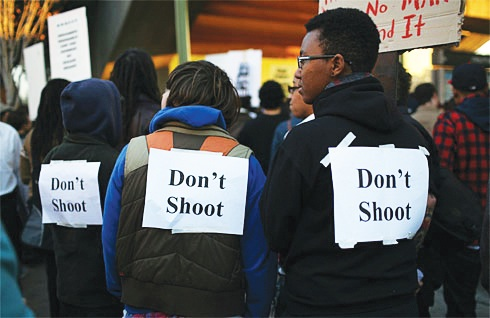 A week after Oscar Grant, 22, was shot in the back by BART police, Oakland youth rallying at that BART station showed they know how vulnerable they are to senseless police murder. Would they be safer with private security guards? - Justin Sullivan, Getty Images