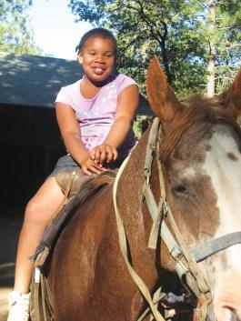 Wanda's granddaughter Brianna Amaya celebrates Feather River Camp's Family Folk Dance Week July 18-24 on horseback. – Photo: Wanda Sabir