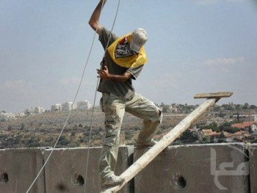 One youth climbed the concrete wall and tied rope to the hand-sized holes in the top of each slab.