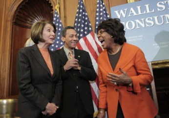 A jubilant Rep. Maxine Waters shares the limelight with fellow Congressional Black Caucus member Rep. Melvin Watt and with House Speaker Nancy Pelosi at a Capitol Hill news conference to announce passage of the Wall Street Reform and Consumer Protection Act Dec. 11. – Photo: AP
