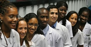 U.S. students of color who promise to return to practice in low-income neighborhoods can become doctors for free at the Latin American School of Medicine in Havana. Though shortages are common in Cuba due to the nearly 50-year U.S. embargo, the island nation has trained an abundance of doctors. When Blacks were abandoned by their own government in New Orleans, Cuba offered to send medical personnel, but the Bush administration immediately rejected the offer. – Photo: AP