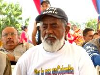 "Venezuelan farmer leader and member of parliament Braulio Alvarez wears a ""Free Mumia"" hat."