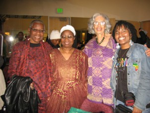 At the celebration of Umoja or unity on Dec. 26, the first day of Kwanzaa, at Youth Uprising, are Geri Abrams, Carol Afua, Makinya Kouate and Wanda Sabir. Sister Makinya is the reason the Kwanzaa ritual is what it is and why it is celebrated throughout the country and world. Maulana Ron Karenga gave her the concept, and through her study and creativity and travel to African nations, she developed the celebration. – Photo: Wanda Sabir