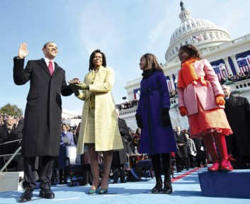 The new First Family beams as Barack Obama is sworn in as the 44th president of the United States. The swearing-in was later repeated because Chief Justice John Roberts flubbed one of the words. – Photo: Chuck Kennedy, Getty Images