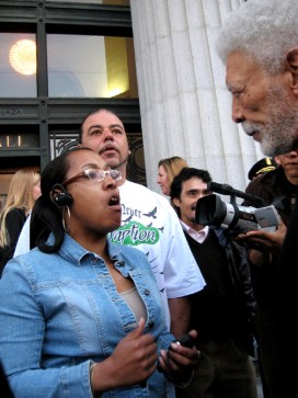 Tracie Cooper, whose son, Michael Greer, was detained with his friend, Oscar Grant, by BART police on New Year's, saw Oscar executed and was then jailed, confronts Mayor Ron Dellums at the Jan. 14 rally. – Photo: Wanda Sabir