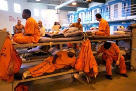 The solution to prison overcrowding, like this packed gym at the California state prison at Lancaster, is to send prisoners home to take care of their families, not to build more prisons. – Photo: Spencer Weiner, AP