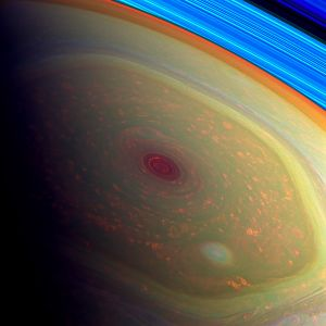 THE NORTHERN STORM This false-colour image from Cassini shows the vast storm at Saturn's north pole, which gathers within the yellow-green, hexagonally shaped jet stream. The storm within the hexagonal ring is 20,000 miles (32,000 kilometres) across, or over twice the diameter of Earth. The eye of the storm, which appears dark red, is 1,250 miles (2,010 kilometres) across and contains speeds up to 330 miles (531 kilometres) per second. Outside the eye, lower clouds are depicted in orange, while a smaller pale-blue vortex (at the bottom, centre-right) indicates a smaller storm within the overall storm. In fact, there are many smaller vortices spinning within the enormous storm; the largest of these spans 2,200 miles (3,540 kilometres), twice the size of the largest hurricane ever recorded on Earth. In this image, the north pole region is framed by Saturn's rings, which appear vibrant blue. Image credit: NASA, JPL-Caltech, SSI The Planets: Photographs from the Archives of NASA text by Nirmala Nataraj, photographs by NASA, preface by Bill Nye (Chronicle Books, £30)