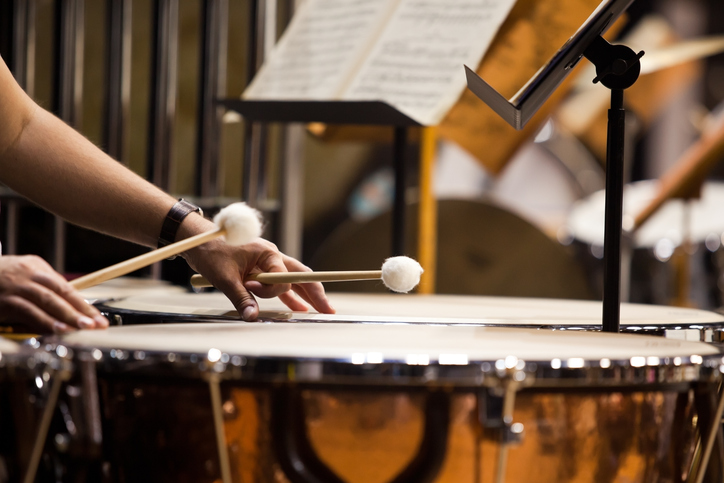 Someone playing the timpani. Representing percussion and world music lessons at sfe music school