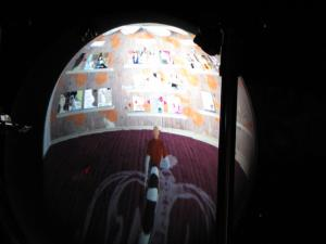 Inside a miniature Second Life pod.