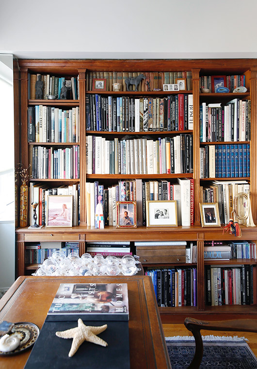 office filled with wood bookcase and collectors items / sfgirlbybay