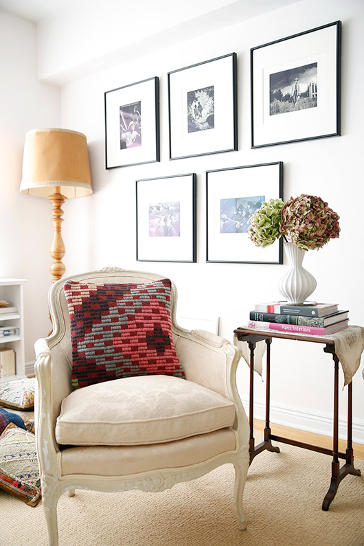 wall of black and white prints in artist abigail doan's living room / sfgirlbybay