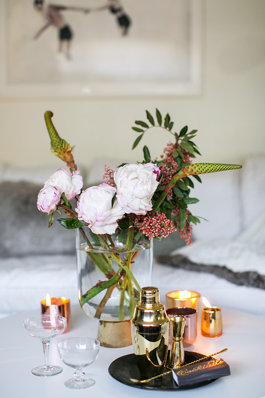 floral arrangement with metallic cocktail set and candles / sfgirlbybay