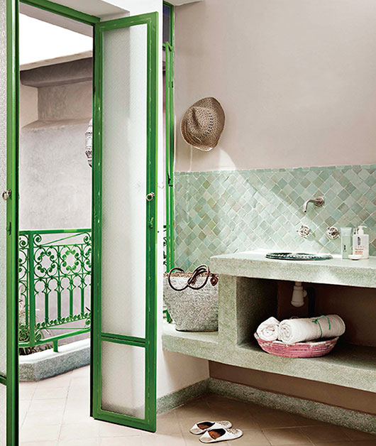 bathroom with muted green tile backsplash / sfgirlbybay
