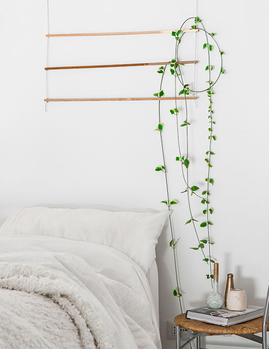white bohemian bed with chair side table and hanging vine / sfgirlbybay