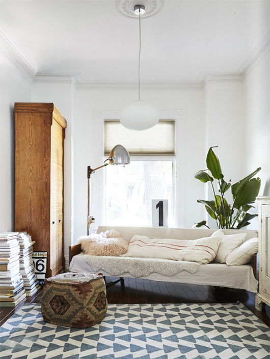 pendant lamp with patterned area rug and wood cabinet / sfgirlbybay