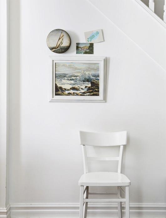 white chair and wall with art prints / sfgirlbybay