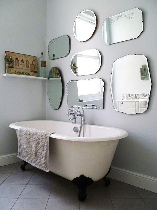 vintage mirrors hung over claw foot tub / sfgirlbybay
