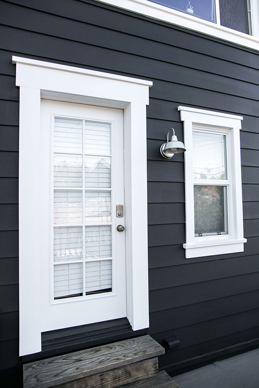black and white benjamin moore exterior paint and industrial sconce light / sfgirlbybay