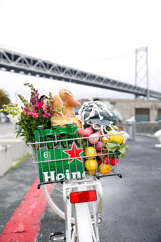 refurbished bike with basket filled with heineken and farmer's market finds / sfgirlbybay